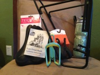 Seat, front rack, bottle holders, pedal clips